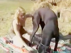 mature blond play with a huge dog